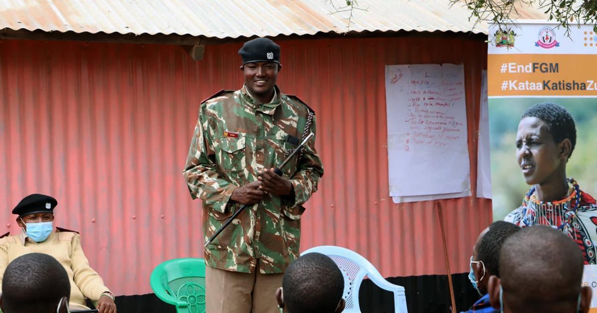 Chief of Kumpa Location talking to Male Champions